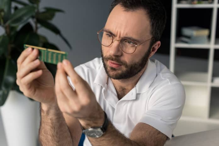 Man looking on ram memory in his hands