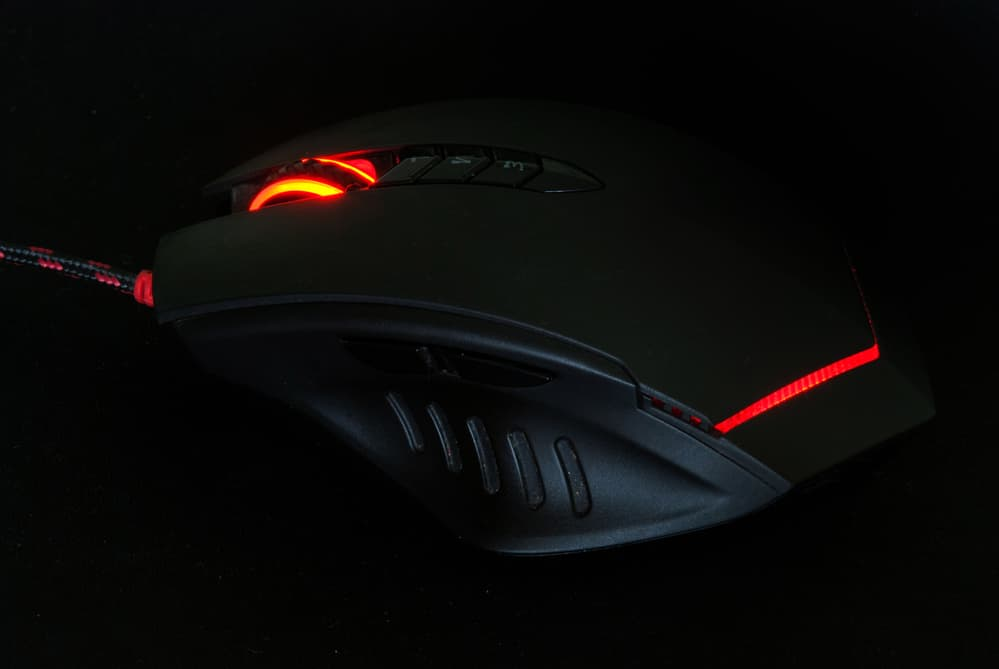 Red light computer gaming mouse in dark tone